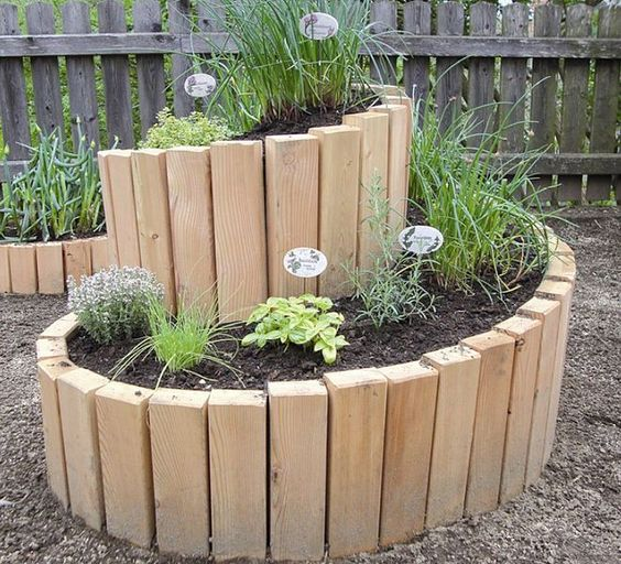 12 unique and fun raised garden bed ideas urban organic for Interesting garden designs