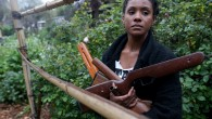 """Bronte Velez, co-founder of Lead to Life, is photographed with guns obtained in a buyback program at her home in Oakland, Calif., on Tuesday, March 20, 2018. Velez and Kyle Lemie will be in Atlanta on April 6-8, the weekend of the 50th anniversary of the assassination of Martin Luther King, to to meet with King's daughter Bernice King and hold an """"alchemy ceremony,"""" where they will finish turning 50 weapons into 50 shovels. They will then use the shovels to plant trees. (Jane Tyska/Bay Area News Group)"""