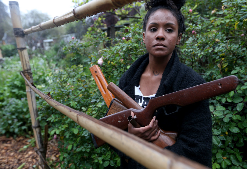 "Bronte Velez, co-founder of Lead to Life, is photographed with guns obtained in a buyback program at her home in Oakland, Calif., on Tuesday, March 20, 2018. Velez and Kyle Lemie will be in Atlanta on April 6-8, the weekend of the 50th anniversary of the assassination of Martin Luther King, to to meet with King's daughter Bernice King and hold an ""alchemy ceremony,"" where they will finish turning 50 weapons into 50 shovels. They will then use the shovels to plant trees. (Jane Tyska/Bay Area News Group)"